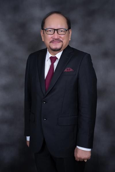 Dr. Christian Johan Lasut, M.Div.,M.Th.,Th.M. (Ketua STT Basom)